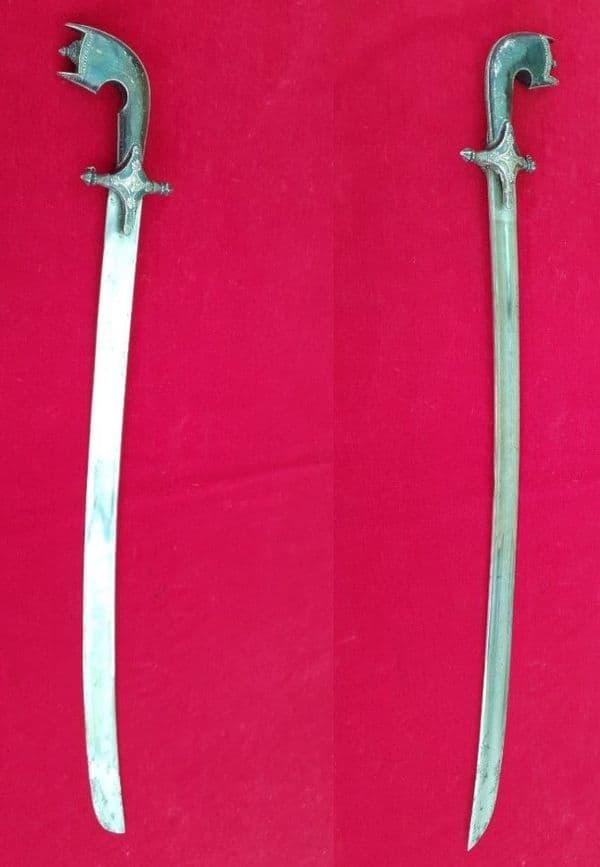 A fine Silver mounted Arab sword Saif or Nimcha in silver mtd scabbard. Good condition. Ref 2619